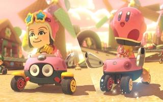 Ontgrendel een <a href = https://www.mariowii-u.nl/Wii-U-spel-info.php?t=Kirby_and_the_Rainbow_Paintbrush>Kirby</a>-kostuum in <a href = https://www.mariowii-u.nl/Wii-U-spel-info.php?t=Mario_Kart_8>Mario Kart 8</a>.