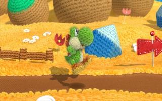 De Wollen Mega-Yoshi verschijnt als een kleine Yoshi in Yoshi&apos;s <a href = https://www.mariowii-u.nl/Wii-U-spel-info.php?t=Yoshis_Woolly_World>Woolly World</a>.